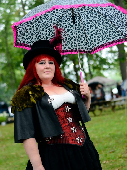 Local steampunk fan Maredith Monroe of York braves the rain for the first ever Steampunk Farmers Market in New Freedom Saturday September 12, 2015. The even featured vendors, live music and a photo scavenger hunt. John A. Pavoncello - jpavoncello@yorkdispatch.com
