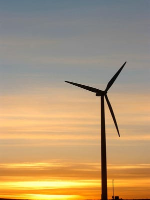 WIND -- The sun sets behind the sole turbine at the Rosebud Casino site in South Dakota. The Owl Feather War Bonnet Wind Farm was expected to be operational now. It would take advantage of a spot in one of the nation's windiest states, using wind as an energy source, but many experts see drawbacks to the system. (Gannett News Service, Cory Myers/(Sioux Falls, S.D.) Argus Leader)