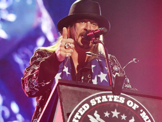 Kid Rock makes gives a political statement from behind