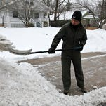 Bob Florez shovels his driveway on Jefferson Avenue on Sunday, March 1, 2015.