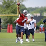 Tennessee Titans quarterback Marcus Mariota (8) passes during a rookie minicamp practice Friday in Nashville, Tenn. (
