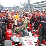 Juan Pablo Montoya celebrates with his crew in victory circle after winning the 99th Indianapolis 500.