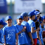 Youths from Chester stand on the third-base line prior to Tuesday's Voyager game.