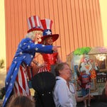 "Residents get their picture taken with ""Uncle Sam"" and his assist during Rockets Over the Red Mesa at the Eureka Casino Resort, 275 Mesa Blvd."