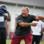 Defensive coordinator Charles Kelly works out high schoolers at FSU's Albert Dunlap Training Facility during Jimbo Fisher's Football Camp Thursday.