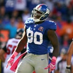 Giants defensive end Jason Pierre-Paul reacts after a play iagainst the Falcons last Oct. 5 in East Rutherford, N.J.