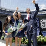 Former New York Yankees catcher Jorge Posada, third from left, and his wife Laura Posada, unveil Posada's plaque that will hang at Monument Park as former teammates Andy Pettitte, far left, and Derek Jeter look on before a baseball game against the Cleveland Indians, Saturday, Aug. 22, 2015, in New York.