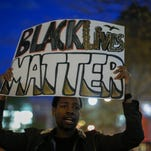A man takes part in a Solidarity With City Of Baltimore rally at Union Square on April 29, 2015 in New York City.