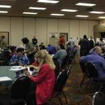 Attendees fill out applications at a Mesquite Regional Business, Inc. job fair Thursday, Feb. 5, 2015 at the CasaBlanca Resort.