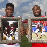 Teammates for eight straight seasons, Rutgers stars Darius Hamilton, left, and Leonte Carroo hold photos from their days a teammates at Don Bosco Preparatory High School.