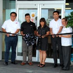 "IP&E celebrated the opening of its second Foody's location Thursday morning at the Barrigada Shell service station.  From left, Richard Behag, IP&E director of supply, distribution, HSSE and engineering; Brian Bamba, IP&E managing director; Barrigada mayor June U. Blas; Tristan Dumlao, Prospector Investments group chief operations officer and Pinki Lujan, Foody's station manager. ""We launched Foody's a year ago at our Micro Mall station, and our customers told us that they wanted more,"" Bamba stated."