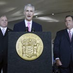 In this 2013 file photo, New Jersey Senate President Steve Sweeney, left, and Gov. Chris Christie, right, listen to United Airlines CEO Jeff Smisek at Newark Liberty International Airport, in Newark, N.J. Smisek, the chairman and CEO of United Airlines is stepping down in connection with an investigation into dealings with the agency that operates New York-area airports.