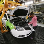 Final trim is installed on a Buick Verano at the Orion Assembly in Orion Township in June. A strong summer for autos helped boost the Comerica Bank Michigan Economic Activity Index.