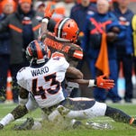 The Denver Broncos' T.J. Ward tackles Cleveland's Duke Johnson on Oct. 18. The Broncos' defense has some comparing them to some of the best defenses in NFL history.