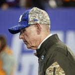 Giants coach Tom Coughlin leaves the field after the Giants' 27-26 loss to the New England Patriots.