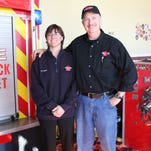 Heather and Dave Herd own Hook & Ladder Pizza Co. They're pictured here in the children's play area that Dave designed. It features a real panel from a fire truck, real turnout gear and helmets and other fire equipment for kids to play with. They also have a fire truck, which Dave — a volunteer firefighter —  opens to kids from time to time to let them crawl on, explore, play with and learn about fire safety.