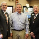 State Sen. Randy Gardner, director Stan Gebhardt and state Rep. Steve Arndt celebrate the Erie-Ottawa International Airport receiving over $639,000 in aviation grant money.