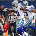 Dallas Cowboys running back Joseph Randle (21) scores a first-quarter touchdown against the Atlanta Falcons at AT&T Stadium.