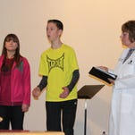 """Berean Baptist Church in Marion will present the Christmas play """"Stories of the Savior"""" at 10:45 a.m. Sunday. From left are Jaelyn Hamilton, Micah Peria and Pat Miller, who play scientists in the production. Rev. Chris Peria is in the background."""