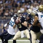 Saints quarterback Drew Brees drops back to pass against the Jaguars on Sunday in New Orleans