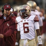 Everett Golson talks to quarterbacks coach Randy Sanders on the sidelines of BB&T Field during the Seminoles' game at Wake Forest earlier in the season.