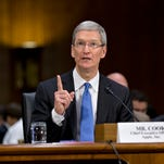 Apple CEO Tim Cook testifies at a Senate Permanent Subcommittee on Investigations hearing on his company's overseas tax strategies in 2013.