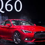 The new Infiniti Q60 sports coupe is unveiled at the North American International Auto Show, Monday, Jan. 11, 2016, in Detroit. (AP Photo/Tony Ding)
