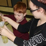 Mackenzie James and her brother, Kingston James, make a lava lamp during Science Night on Dec. 16, 2015, at Quarter Mile Lane School in Bridgeton.