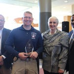 Monroe Police Detective Christopher Turner (second from left) was recognized as NDRTA's Instructor of the Year for 2015.