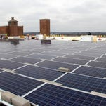 More than 400 electricity-generating solar panels operate on the roof of Cornerstone Center for the Arts.