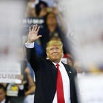 Brynn Anderson/ APRepublican presidential candidate Donald Trump waves to the crowd before he speaks during a campaign rally Saturday in Orlando, Fla. Republican presidential candidate Donald Trump waves to the crowd before he speaks during a campaign rally Saturday in Orlando, Florida.