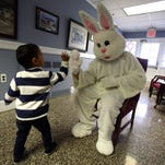 Manjusha Patankar of Parsippany looks on as her 6-year-old daughter Ramaa gives the Easter bunny a high-five as the Township of Parsippany-Troy Hills hosts a visit from the Bunny at the Parsippany Municipal Building for children of all ages. March 19, 2016. Morristown, N.J.