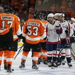 The Washington Capitals and Philadelphia Flyers shake hands at the end of Game 6.