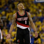 Portland Trail Blazers' Damian Lillard (0) during the second half in Game 1 of a second-round NBA basketball playoff series against the Golden State Warriors Sunday, May 1, 2016, in Oakland, Calif. Golden State won 118-106. (AP Photo/Marcio Jose Sanchez)