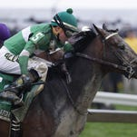 Exaggerator with Kent Desormeaux aboard moves past Nyquist with Mario Gutierrez up at the Preakness Stakes on Saturday in Baltimore. Exaggerator won the race by 31/2 lengths.