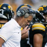 Iowa coach Kirk Ferentz huddles with players during a timeout against North Dakota State Saturday. Ferentz's team was outrushed 239-34.