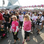 People line up Sunday at the start for the Susan G. Komen Race For The Cure in Milwaukee. The race and walk raises money for the fight against breast cancer. It started at the Milwaukee Art Museum along the lakefront.