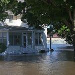 Monday photos: Flooding near Vinton, Palo