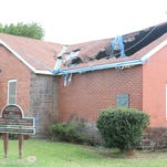 Get 'Er Done: Gaping hole in roof near housing complex