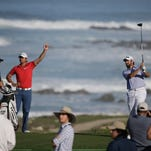 Michael Thompson, right, follows his drive from the 13th tee of the Monterey Peninsula Country Club Shore Course as playing partner Jason Day, second from left, looks on during the second round of the AT&T Pebble Beach National Pro-Am on Friday.