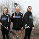 Shore Regional lacrosse players Megan Racioppi, Lauren Britton and Emily Olsen pose during practice at Manahassett Park in Long Branch, NJ Friday March 27, 2015. ASB 0403 Girls Lacrosse Preview
