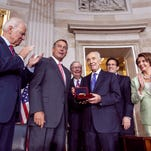 Israeli President Shimon Peres, center, is honored at a Congressional Gold Medal ceremony  Thursday on Capitol Hill in Washington. From left are, Vice President Joe Biden, House Speaker John Boehner of Ohio, Senate Minority Leader Mitch McConnell of Ky., Peres, House Majority Leader Eric Cantor of Va., and House Minority Leader Nancy Pelosi of California.