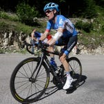 Andrew Talansky of the U.S. strains as he rides alone with more than 20 minutes delay on the pack because of back pain during the eleventh stage of the Tour de France cycling race over 187.5 kilometers (116.5 miles) with start in Besancon and finish in Oyonnax, France, Wednesday, July 16, 2014. Talansky crashed twice in the first week of the Tour.