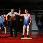 Zeljko Caculovic of Urbandale is recognized after defeating Justin Overmeyer of Roosevelt by technical fall during a 138-pound match at Urbandale on Thursday. Urbandale took the dual by a 57-22 score.