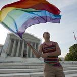 Gay rights advocate Vin Testa waves a flag in front of the Supreme Court in Washington in 2013. Both sides in the gay marriage debate agree on one thing: It's time for the Supreme Court to settle the matter. An emerging consensus makes it likely that the justices soon will agree to take up the question of whether the Constitution forbids states from defining marriage as the union of a man and a woman. While a final ruling isn't likely before June of next year, a decision to get involved could come as soon as the end of this month.