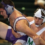 Fort Myers? Levi McQuinn, shown on right wrestling Cypress Lake's Brandon Cashatt, is one of three Wave athletes at the state finals. Terry Allen Williams/The News-Press Fort Myers High wrestler Levy McQuinn,right, tries to get a hold on Cypress Lake's Brandon Cashatt during a championship match in the 170lb division Saturday at the LCAC Wrestling Championship at Island Coast High. McQuinn won the match and took first place.