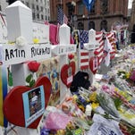 Shortly after the Boston Marathon bombing in April 2013, a makeshift memorial arose to victims Martin Richard, Lingzi Lu and Krystle Campbell.