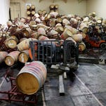 Some of the hundreds of earthquake damaged wine barrels cover and toppled a pair of forklifts at the Kieu Hoang Winery, Monday, Aug. 25, 2014, in Napa, Calif. A powerful earthquake that struck the heart of California's wine country caught many people sound asleep, sending dressers, mirrors and pictures crashing down around them and toppling wine bottles in vineyards around the region. The magnitude-6.0 quake struck at 3:20 a.m. PDT Sunday near the city of Napa.