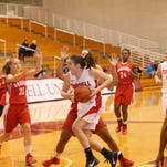 Nicholle Aston drives to the basket against Hartford in the season opener on Nov. 14 at Newman Arena. Aston led Cornell past Columbia last weekend, getting 14 points and 10 rebounds and earning Ivy League Player of the Week honors. Cornell travels to Brown on Friday and Yale on Sunday.