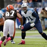 Tennessee Titans tackle Michael Roos (71) plays against Cleveland Browns linebacker Jabaal Sheard (97) in the fourth quarter of an NFL football game Sunday, Oct. 5, 2014, in Nashville, Tenn. (AP Photo/Wade Payne)
